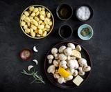 Ingredients for preparing mushrooms and gnocchi dish,selective focus - 218864398