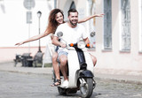 Cool man and beautiful girl riding on  scooter with  expression - 218882100