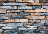 Stone wall texture with mud joints - 218902946