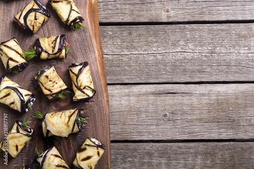 Fototapeta Grilled eggplant (aubergine) rolls with cream cheese