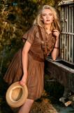 Pretty blonde girl in safari summer khaki dress - 218919743