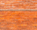 Glazed brick wall texture with a frieze in the top third - 218920564
