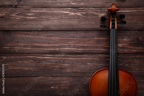 Fototapeta Violin on brown wooden table