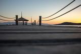 Wodden pier during a summer sunset.