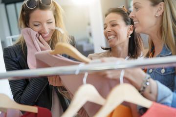 Girlfriends having fun shopping at clothing store © goodluz