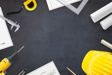Construction industry concept. Projects and tools on work desk with free space for text. Hero header image concept. Flat lay, Top view. © Stanisic Vladimir