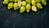 Fresh pears on a black stone table. Fruits. Free space for text. Top view. - 219016512