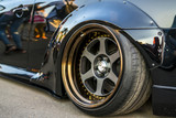 a close up fast deluxe muscle car big wheel
