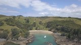 Large view of Paradisiac blue bay rock and jungle coast. Boats and beach, Waiheke island New Zealand. - 219048944