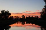Fantastic sunset on forest river