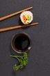 maki sushi and soy sauce