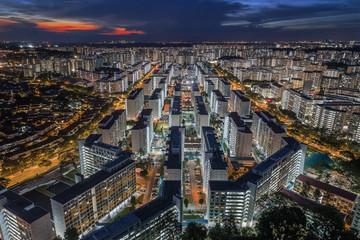 Aerial view of concrete jungle like HDB apartments in Singapore at night © PRADEEP RAJA