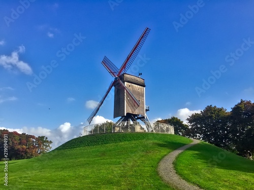 Windmill on a hill on a sunny day on bruges belgium