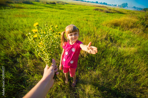 Foto Murales Happy mothers day! Child daughter is congratulating mom and giving her flowers bouquet. Family holiday and togetherness.