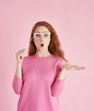 Portrait of surprise woman gesturing at studio shot - 219117759