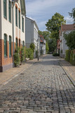 City of Neumunster Germany Sleeswijk Holstein. Alley with cobblestones