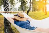 Woman resting in hammock. Sleeping outdoors. - 219121532