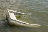 Half sunken boat in sea - 219126370