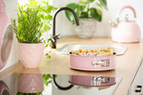 Real photo with close-up of homemade cake placed on countertop with fresh plants - 219127362