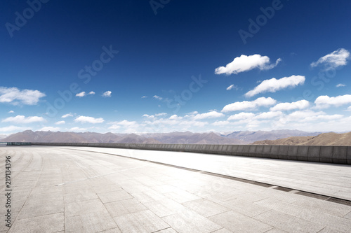 empty ground with blue sky - 219134396