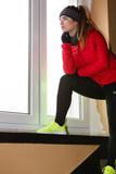 Woman wearing warm sportswear at home