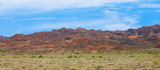 colorful colored mountains in summer, blue sky with clouds, Kazakhstan, Altyn-Emel mountains - 219153119