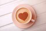 Cup of coffee with heart on foam. morning coffee