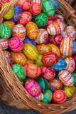 Wicker basket with Easter painted eggs - 219169716