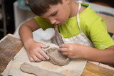 Pottery workshop for kids, raw clay, sculpting tools, glazing and painting clay pots - 219188379