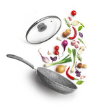 Vegetable composition. Frying pan with lid and flying vegetables, isolated on white background - 219188906