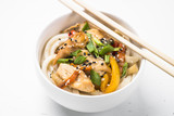 Udon stir-fry noodles with chicken and vegetables on white. - 219194963