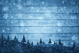 Silhouette of trees on the hills with textured wooden planks st snowy day. Blue Christmas and New Year holiday greeting card background.  - 219197377