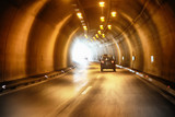 Dangerous car driving in the tunnel. Dangerous high speed motion blurred vehicle driving. Motion blur symbolizes the speed and dynamics. - 219197555