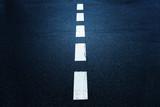 White dotted line on dark blue city asphalt road background.  - 219197576