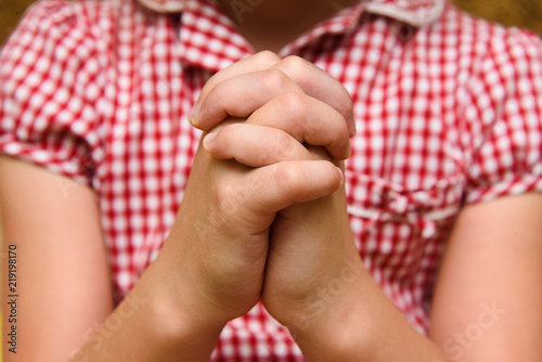 Hands of a praying child