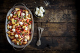 Prepared healthy salad with vegetables,baked bread and mozzarella served on the wooden background with blank space,selective focus - 219210950