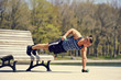 Young athlete doing inclined push ups with weights
