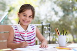 Happy Smiling Preschool Child Girl Drawing Pictures Outdoors in Garden in Summer Time - 219220953