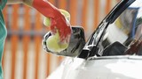 hand holding sponge washing side mirrors of a car - 219237737