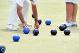 People bowling on a bowling green - 219255592