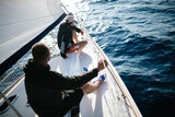Handsome strong men sailing with their boat - 219274774