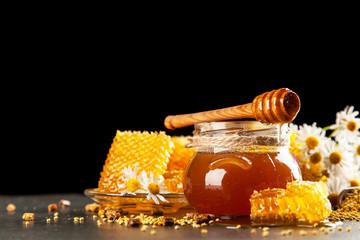 Honey jar and dipper © George Dolgikh
