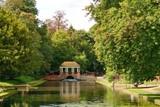 Oriental bridge structure, over river Dour in Russel gardens in Kent UK. Cascade under bridge arch. - 219310939
