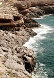 Waves hitting the rocks on the seashore