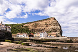 Staithes, North Yorkshire, UK.  A view of Staithes harbour and the Cowbar Nab headland. - 219324368