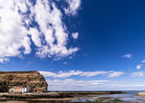 Staithes, North Yorkshire, UK.  A view of Staithes harbour and the Cowbar Nab headland. - 219324991