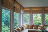 brown roman blind shade curtain tree forest mountain background living room - 219325348