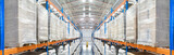 Panorama of a modern newest huge distribution warehouse with high shelves and big ventilation pipes on the ceiling. Top view