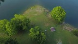 Aerial shot above river and green forest during sunrise - 219334130