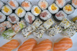 Assorted sushi set served on white plate.